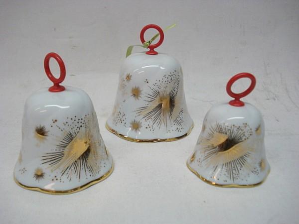 Porzelan Glockenset besteht aus 3 unterschiedlich Größen Motiv goldene Sterne