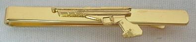 Krawattenschieber Pistole gold -